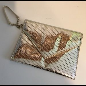 Handbags - 👗 Silver Cosmetic Bag $7 or Free w/$20+ Bundle